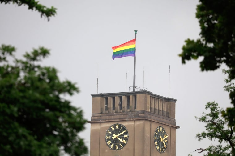 Image: A rainbow flag flutters on the city hall of Berlin's Schoeneberg district on June 30, 2017.