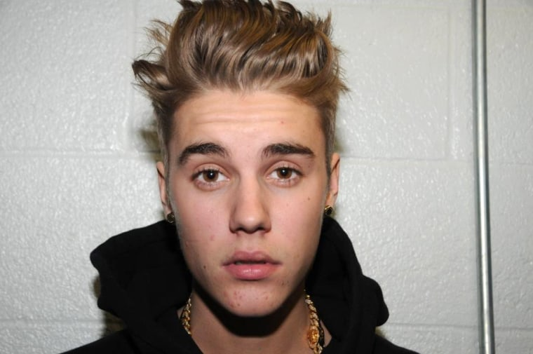 Image: Justin Bieber's 2014 booking photo from Miami Beach Police Department.
