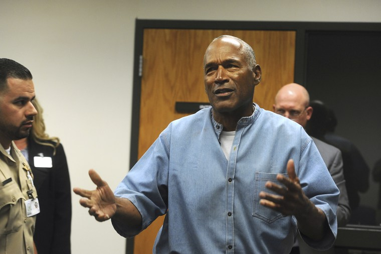 Former NFL football star O.J. Simpson reacts after learning he was granted parole at the Lovelock Correctional Center in Lovelock, Nev., on Thursday, July 20, 2017.