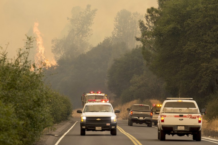 Image: The Detwiler fire burns along Highway 49 in Mariposa County on July 18.
