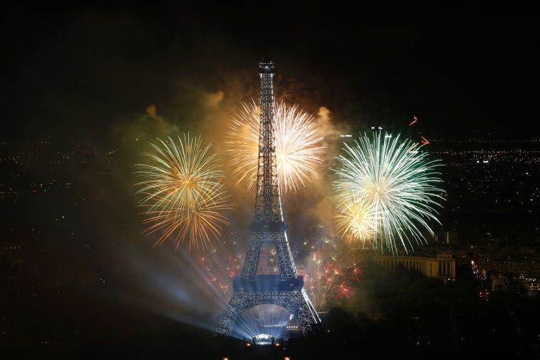 Image: Fireworks light the sky above the Eiffel Tower