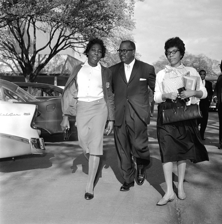 Image: Mary Briscoe (left) and Sandra Ann Jones are escorted by the Rev. T.J. Jemison