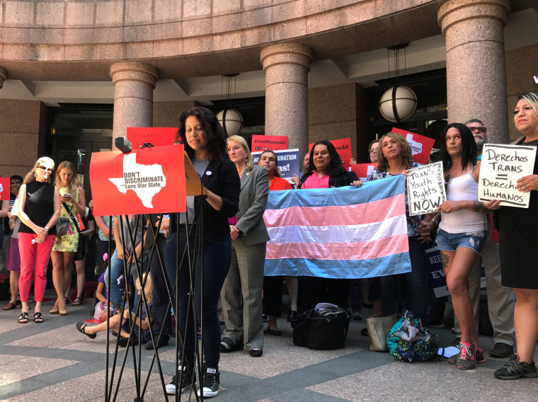 """Image: Angie Castro speaks at a rally against a """"bathroom bill"""" at the Texas Capitol in Austin"""