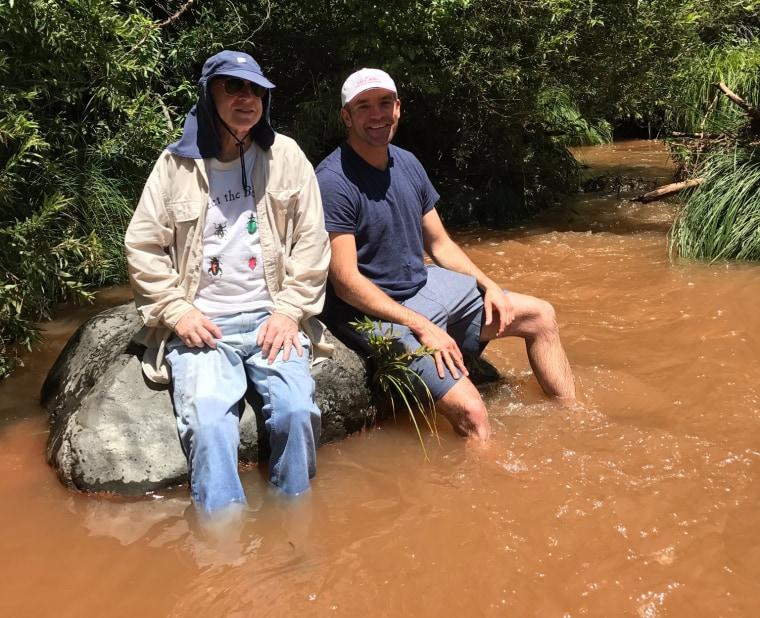 Image: John McCain and Joe Harper sit on a rock at Zebra Falls