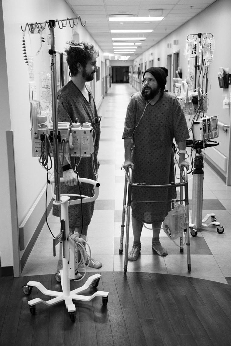Robbins and Fox at the hospital after surgery. Doctors placed their recovery rooms far apart to encourage them to be active.