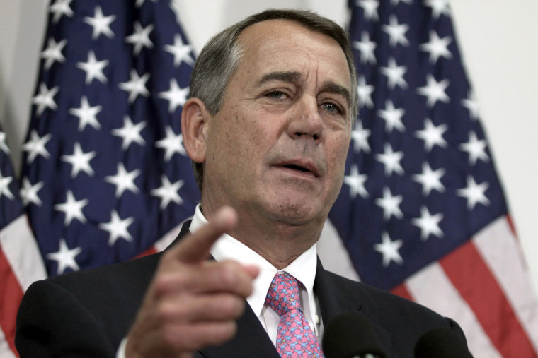 Image: Then-House Speaker John Boehner of Ohio talks with reporters on Capitol Hill in Washington