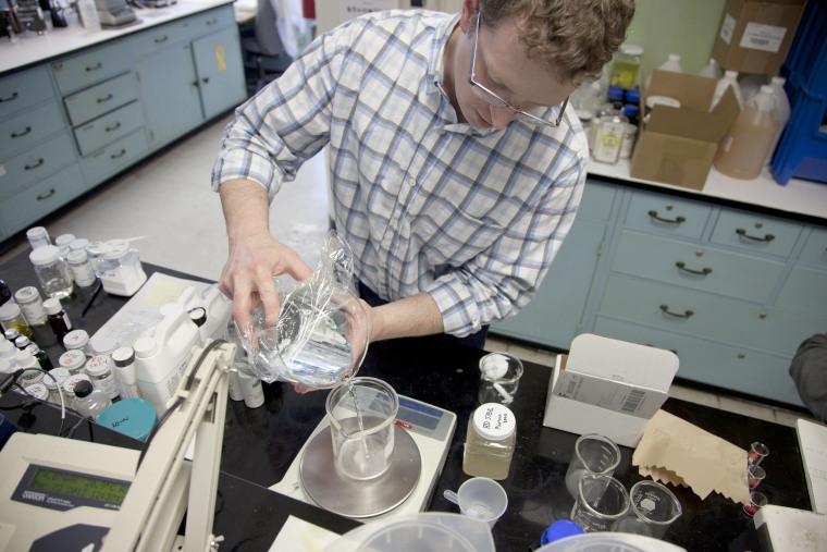 Image: Research and development chemist John Pantzer checks the compatibility of a natural lemon fragrance to be used in window cleaner at the J.R. Watkins production facility in Winona, Minnesota, March 21, 2013.