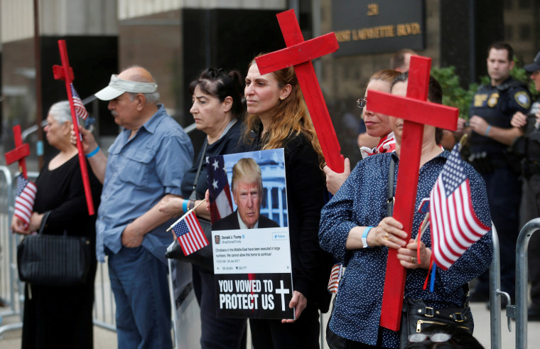 Image: FILE PHOTO: Protesters rally outside the federal court just before a hearing to consider a class-action lawsuit filed on behalf of Iraqi nationals facing deportation, in Detroit