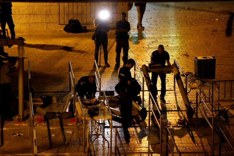 Image: Israeli security forces remove metal detectors which were recently installed at an entrance to the compound known to Muslims as Noble Sanctuary and to Jews as Temple Mount in Jerusalem's Old City