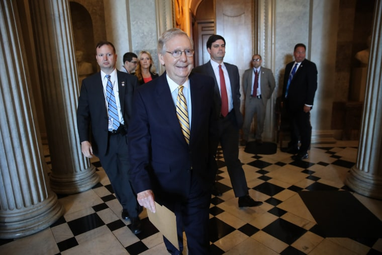 Image: Mitch McConnell walks to a meeting in the Capitol