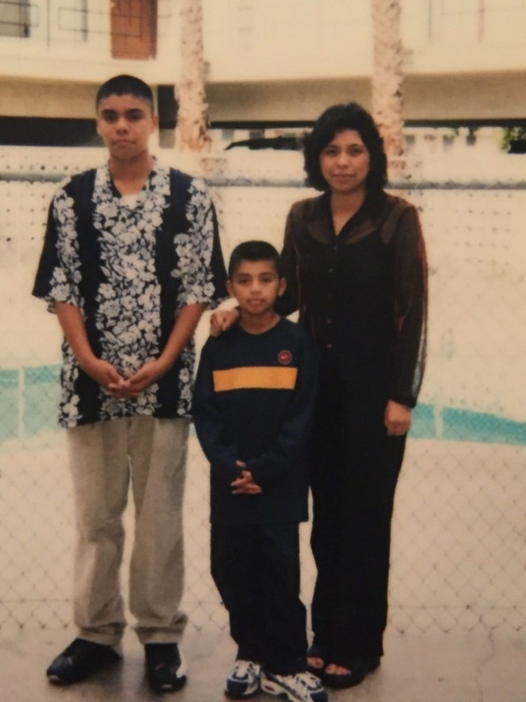 Rogelio Garcia as a teen with his mom and brother.