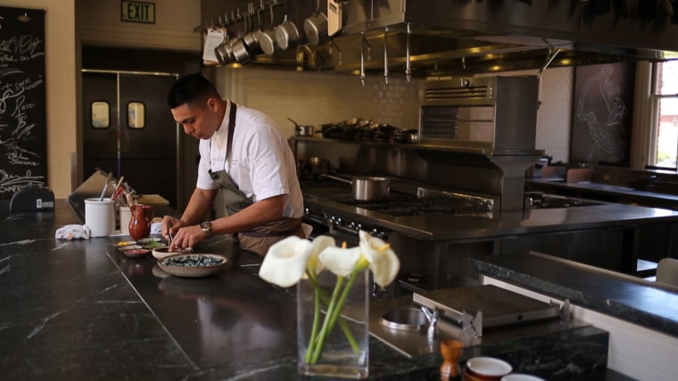 Garcia prepares a dish at The Commissary in San Francisco.