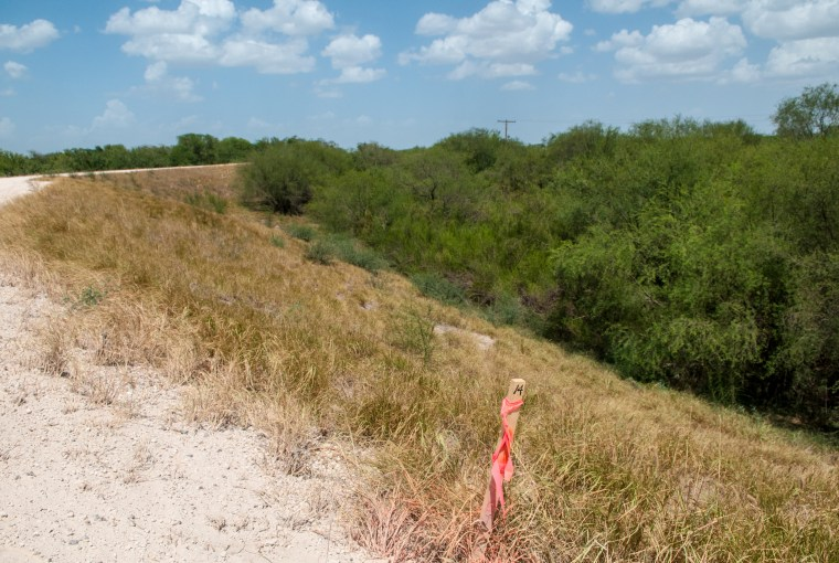 Image: A surveyor stake is seen on the property of the National Butterfly Center in Mission, Texas.