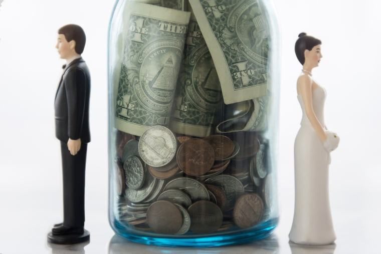 Image: Close Up of Bride and Groom Dolls Near Savings Jar