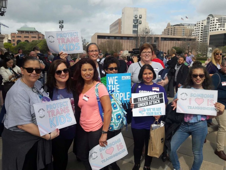 """A group of """"Mamma Bears"""" and other allies at a rally at the Texas State Capitol in Austin, Texas, on March 6, 2017. Front row (L-R): Maria Clinkscales, Carrie Kinghorn, Angie Castro, Danny Castro, Laura Venegas and Roxy Castro. Back row (L-R):  Brandi Spear and Michele Pettigrew."""