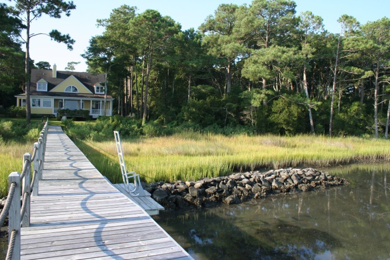 A living shoreline (granite rock sill with salt marsh, both natural and planted) in front of a house on Bogue Banks in NC