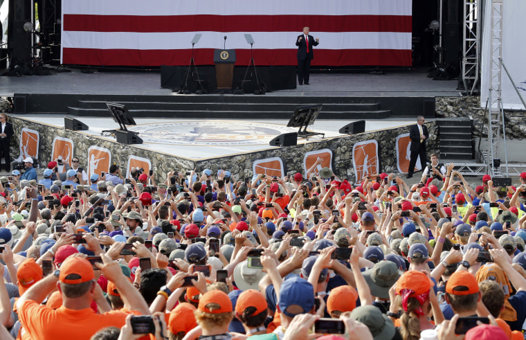 Image: President Donald Trump waves to the crowd of scouts at the 2017 National Boy Scout Jamboree