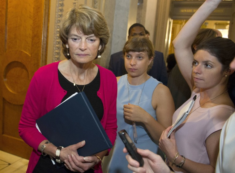 Image: Sen. Lisa Murkowski, R-Alaska., passes reporters as she leaves the Senate Chamber after voting 'no' on a a measure to repeal parts of former President Barack Obama's health care law