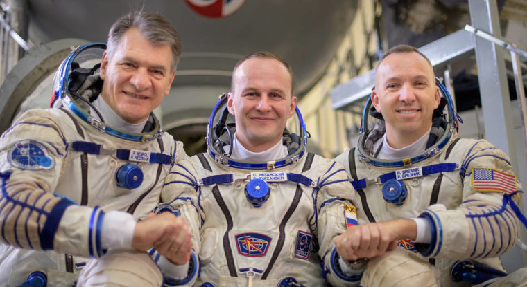 Expedition 52 flight engineers Paolo Nespoli of the European Space Agency, left, Sergey Ryazanskiy of Roscosmos, and Randy Bresnik of NASA outside a Soyuz simulator.