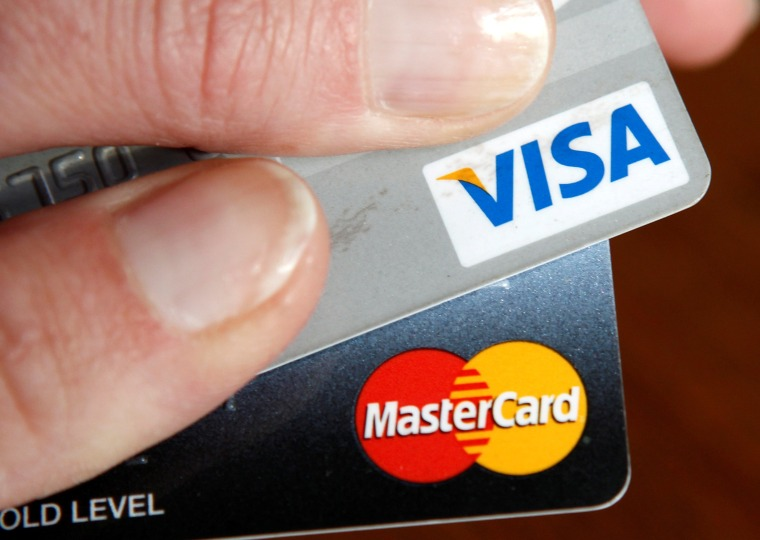 Image: FILE PHOTO: A consumer holds her credit cards in Washington