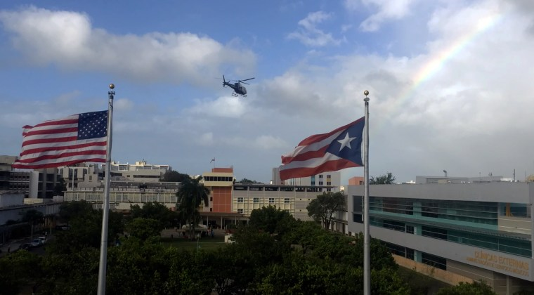 A helicopter lands on the roof of Puerto Rico Medical Center in San Juan.