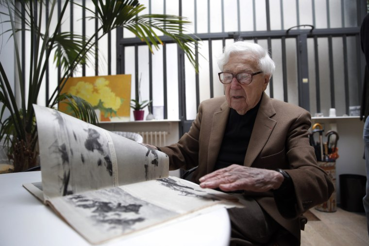 FILE- In this file photo dated Friday, May 2, 2014, John Morris, legendary Life Magazine and New York Times photo editor, speaks during an interview with the Associated Press in Paris, France.