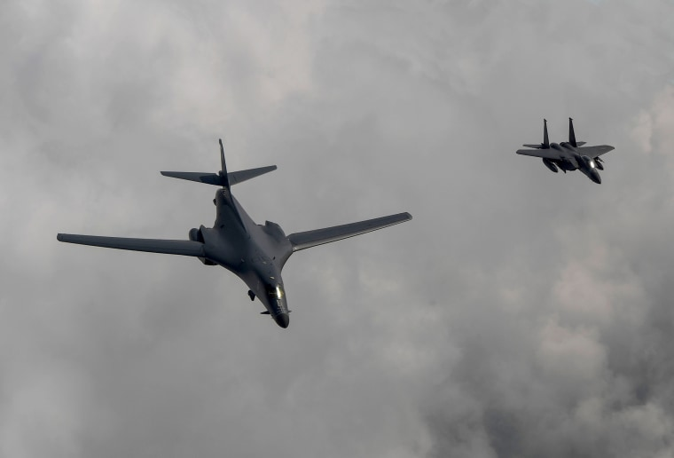 Image: A U.S. Air Force B-1B Lancer bomber (L) fly with South Korean fighter jet F-15K fighter jet over the Korean Peninsula during a South Korea-U.S. joint live fire drill aimed to counter North Korea's missile test on July 30, 2017.