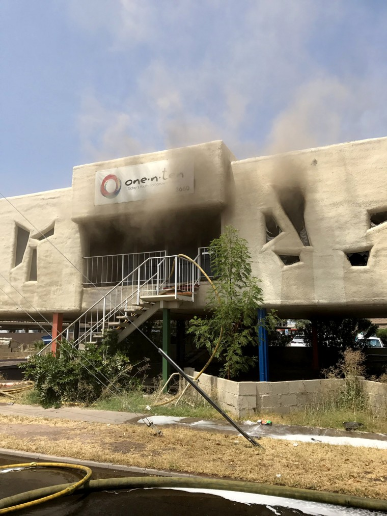 Image: An LGBT center is shown, on fire, as emergency service crews investigate for arson, July 30, 2017, Phoenix, Arizona.