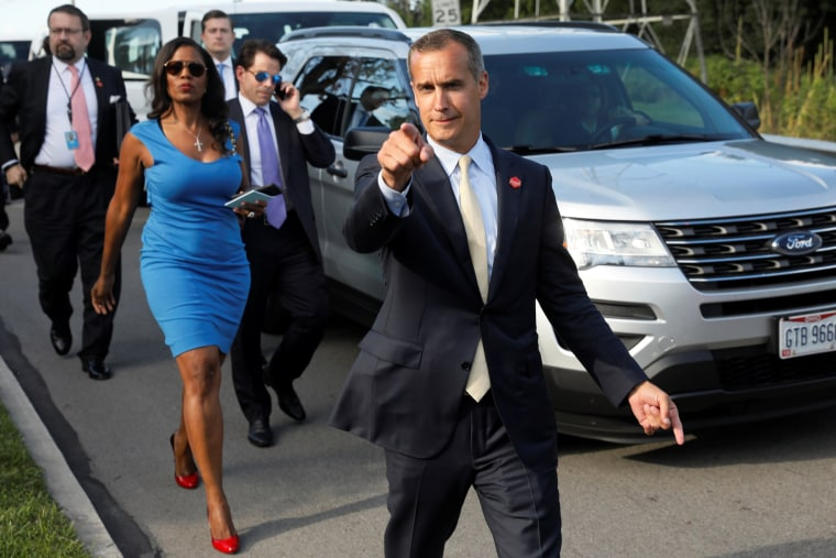 Image: Lewandowski says hello to reporters as he and Gorka, Manigault and Scaramucci accompany Trump for an event celebrating veterans at AMVETS Post 44 in Struthers, Ohio