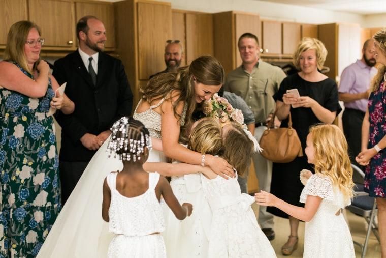 Marielle Slagel Keller greets her students after her wedding ceremony.