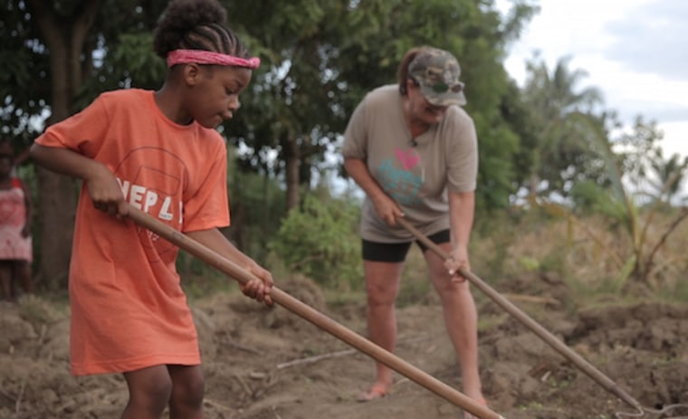 Harper and Missy working on the community garden they sponsor in Missy's birth village.