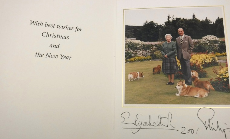 The Queen and Prince Philip pose with their beloved corgis in the 2001 card.