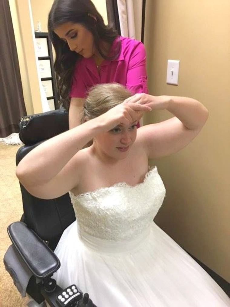 Julie McMillian shops for a wedding dress while in a wheelchair