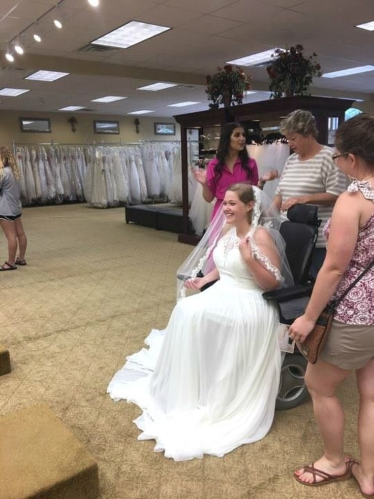 Julie McMillian shops for wedding dress in a wheelchair