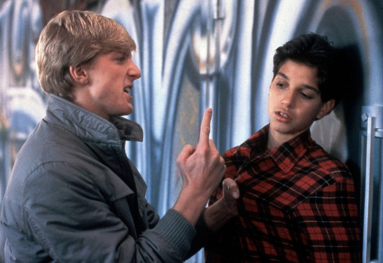 "William Zabka and Ralph Macchio facing off in 1984's ""Karate Kid."""