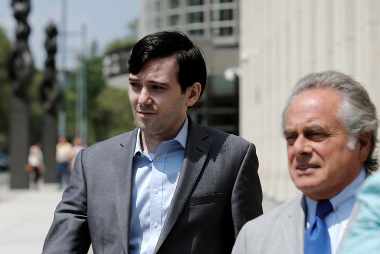 Image: Shkreli departs with his attorney Brafman following a hearing at U.S. Federal Court in Brooklyn, New York