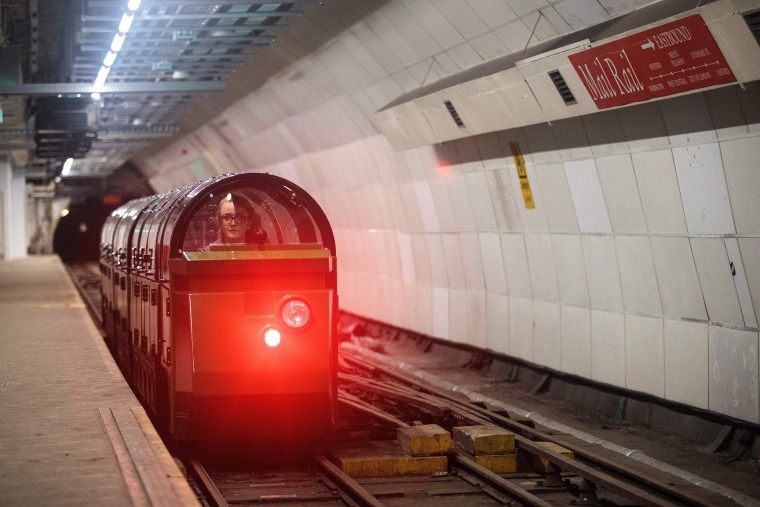 Image: Mail Rail train driver Penelope Veck drives through the underground eastbound