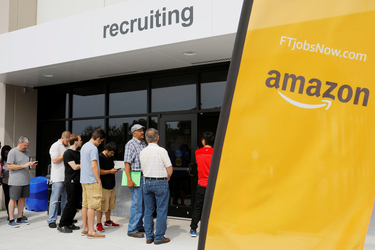 """Image: Job seekers line up to apply during """"Amazon Jobs Day"""" at the Amazon.com Fulfillment Center in Fall River"""