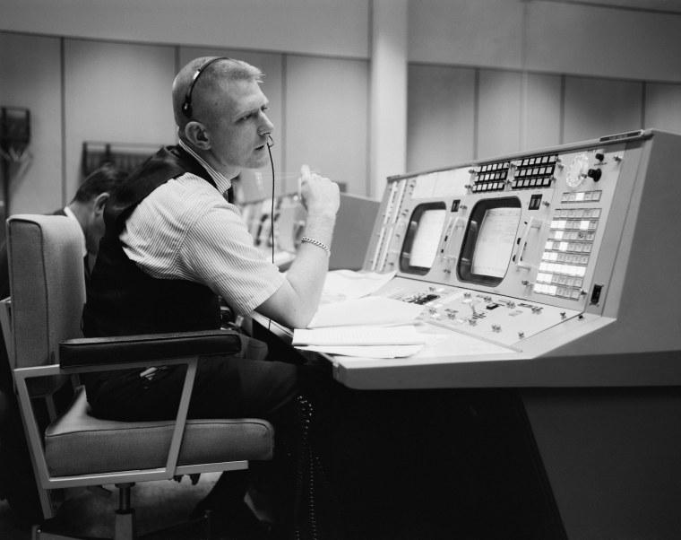 Gene Kranz at his desk in the original mission control room during the Apollo era.