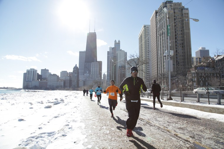 Mohan Iyer running a race along a frozen lake path in Chicago.