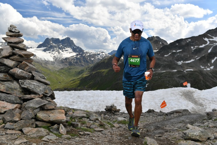 Mohan Iyer running a race in the Swiss Alps.