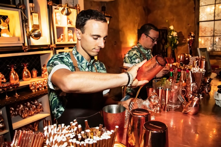 Maxime Belfand and Davide Segat serving Elyx cocktails at House of Elyx at Tales of the Cocktail.