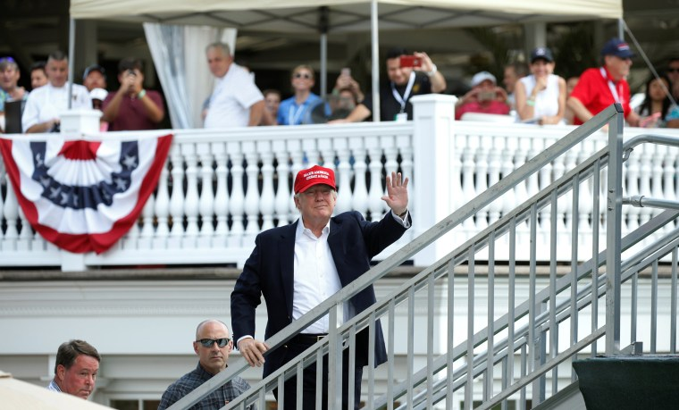 Image: Trump attends the U.S. Women's Open at his golf course in Bedminster, New Jersey
