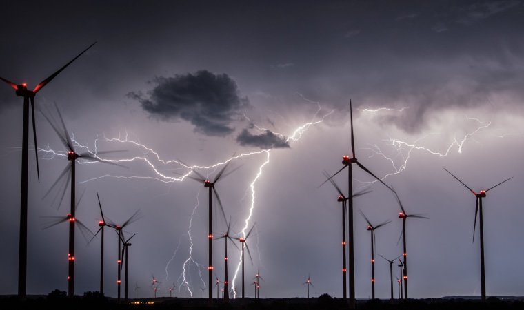 Image: Lightning flashes over wind turbines