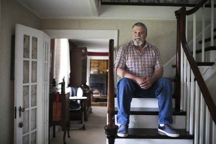 Image: Larry Harmon sits in his home in Kent, Ohio, on Aug. 4, 2017. Harmon was removed from the voting rolls after not voting in the last election.
