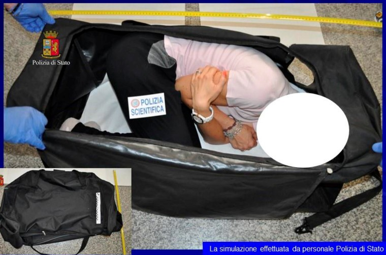 Image: A person taking part in a reenactment by Italian police on how a kidnapped British model was kept in a bag