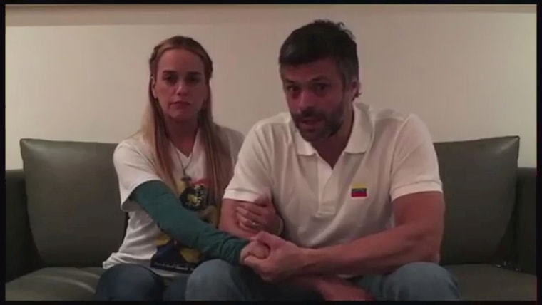 Image: FILE PHOTO: A still image taken from a video released on August 1, 2017 shows opposition leader Leopoldo Lopez and his wife Lilian Tintori talking in their house in Caracas