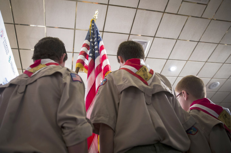 Image: Boy Scouts stand on stage with a U.S. flag during the Pledge of Allegiance, April 12, 2014.