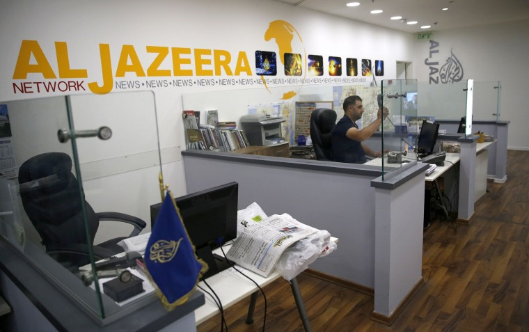 Image: An employee of the Qatar based news network and TV channel Al-Jazeera is seen at the channel's Jerusalem office on July 31, 2017.