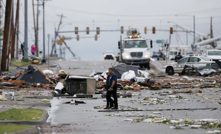 Image: Debris from a storm covers a street in Tulsa, Oklahoma, Aug. 6, 2017. A possible tornado struck near midtown Tulsa and causing power outages and roof damage to businesses.